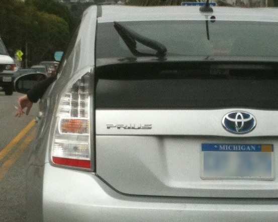 Picture of Someone Smoking While Driving a Prius