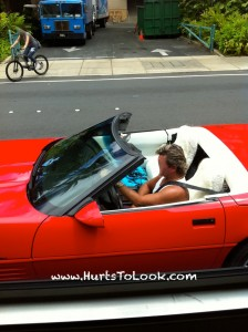 Photo of Red Convertible Corvette Driven by Frosted Mullet Man